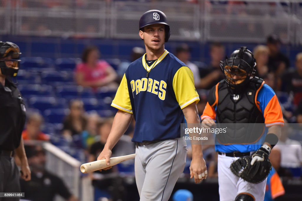 Wil Myers #4 of the San Diego Padres walks back to the dugout after striking out in the eighth inning against the Miami Marlins at Marlins Park on August 27, 2017 in Miami, Florida.