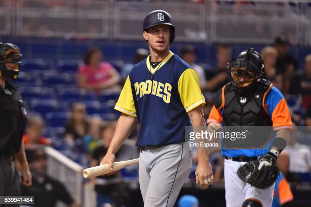 Wil Myers of the San Diego Padres walks back to the dugout after striking out in the eighth inning against the Miami Marlins at Marlins Park on...