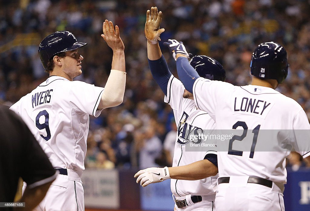 <a gi-track='captionPersonalityLinkClicked' href=/galleries/search?phrase=Wil+Myers&family=editorial&specificpeople=7562808 ng-click='$event.stopPropagation()'>Wil Myers</a> #9 of the Tampa Bay Rays celebrates with Matt Joyce #20 (C) and <a gi-track='captionPersonalityLinkClicked' href=/galleries/search?phrase=James+Loney&family=editorial&specificpeople=636293 ng-click='$event.stopPropagation()'>James Loney</a> #21 after all scoring off of Myers' three-run home run during the fifth inning of a game against the New York Yankees on April 19, 2014 at Tropicana Field in St. Petersburg, Florida.