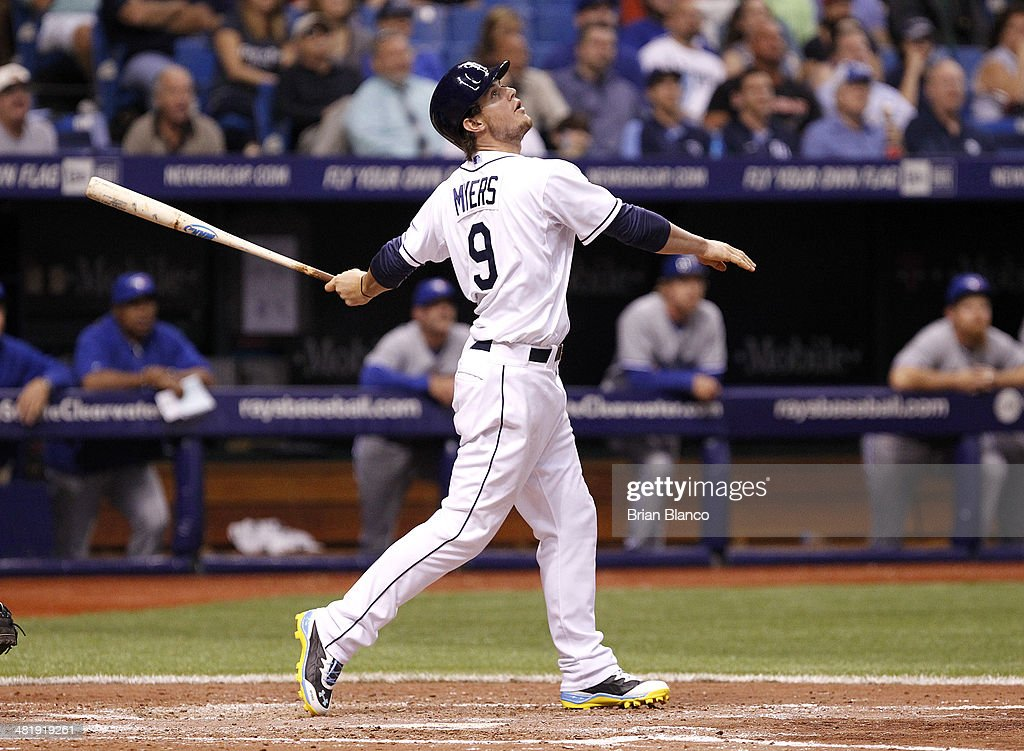 <a gi-track='captionPersonalityLinkClicked' href=/galleries/search?phrase=Wil+Myers&family=editorial&specificpeople=7562808 ng-click='$event.stopPropagation()'>Wil Myers</a> #9 of the Tampa Bay Rays flies to right field with two men on during the sixth inning of a game against the Toronto Blue Jays on April 1, 2014 at Tropicana Field in St. Petersburg, Florida.