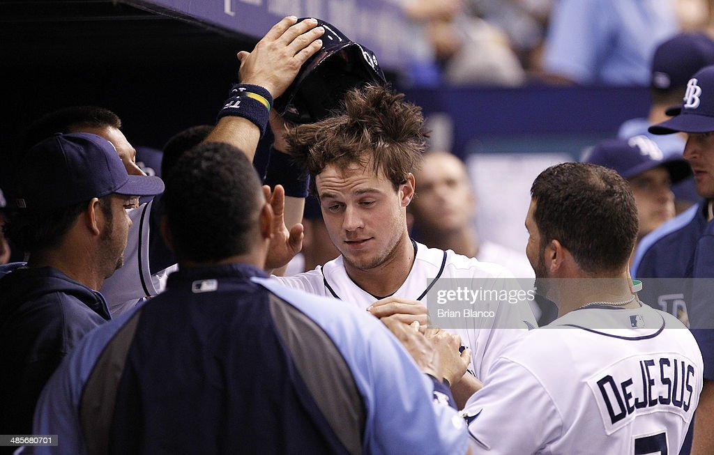 Wil Myers #9 of the Tampa Bay Rays has his helmet taken off his head by teammate Ben Zobrist (L) as he celebrates in the dugout following his solo home run during the second inning of a game against the New York Yankees on April 19, 2014 at Tropicana Field in St. Petersburg, Florida.