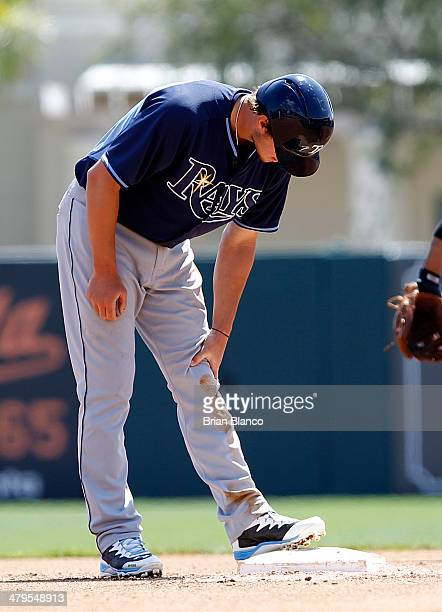 Wil Myers of the Tampa Bay Rays holds his left knee after stealing second base during the fourth inning of a spring training game against the...