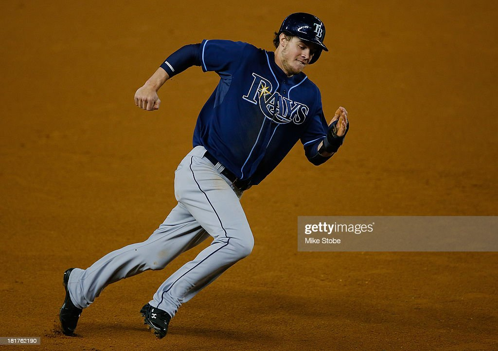 <a gi-track='captionPersonalityLinkClicked' href=/galleries/search?phrase=Wil+Myers&family=editorial&specificpeople=7562808 ng-click='$event.stopPropagation()'>Wil Myers</a> #9 of the Tampa Bay Rays rounds third and scores on a <a gi-track='captionPersonalityLinkClicked' href=/galleries/search?phrase=David+DeJesus&family=editorial&specificpeople=206765 ng-click='$event.stopPropagation()'>David DeJesus</a> RBI double in the first inning against the New York Yankees at Yankee Stadium on September 24, 2013 in the Bronx borough of New York City. The Rays defeated the Yankees 5-0.