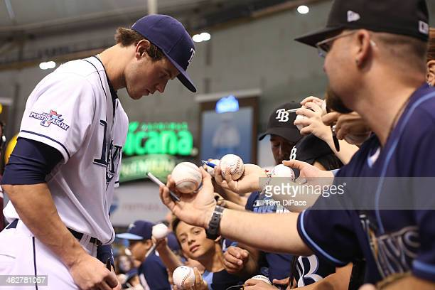 Wil Myers of the Tampa Bay Rays signs autographs before Game 3 of the American League Division Series against the Boston Red Sox at Tropicana Field...