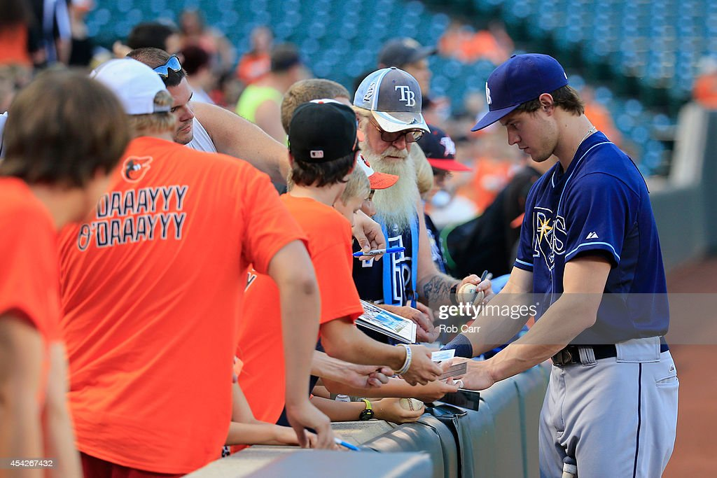 Wil Myers #9 of the Tampa Bay Rays signs autographs before the start of their game against the Baltimore Orioles at Oriole Park at Camden Yards on August 27, 2014 in Baltimore, Maryland.