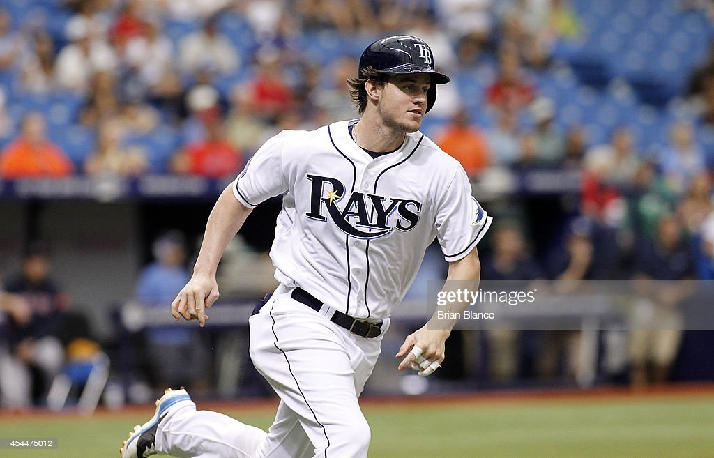 <a gi-track='captionPersonalityLinkClicked' href=/galleries/search?phrase=Wil+Myers&family=editorial&specificpeople=7562808 ng-click='$event.stopPropagation()'>Wil Myers</a> #9 of the Tampa Bay Rays sprints toward first base after hitting an RBI double off of pitcher Rubby De La Rosa #62 of the Boston Red Sox during the third inning of a game on September 1, 2014 at Tropicana Field in St. Petersburg, Florida.