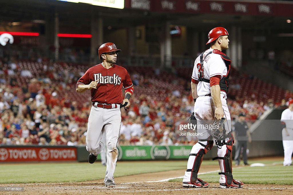 <a gi-track='captionPersonalityLinkClicked' href=/galleries/search?phrase=Wil+Nieves&family=editorial&specificpeople=835752 ng-click='$event.stopPropagation()'>Wil Nieves</a> #27 of the Arizona Diamondbacks scores a run after a throwing error by Brandon Phillips of the Cincinnati Reds in the eighth inning of the game at Great American Ball Park on August 21, 2013 in Cincinnati, Ohio. The Reds won 10-7.