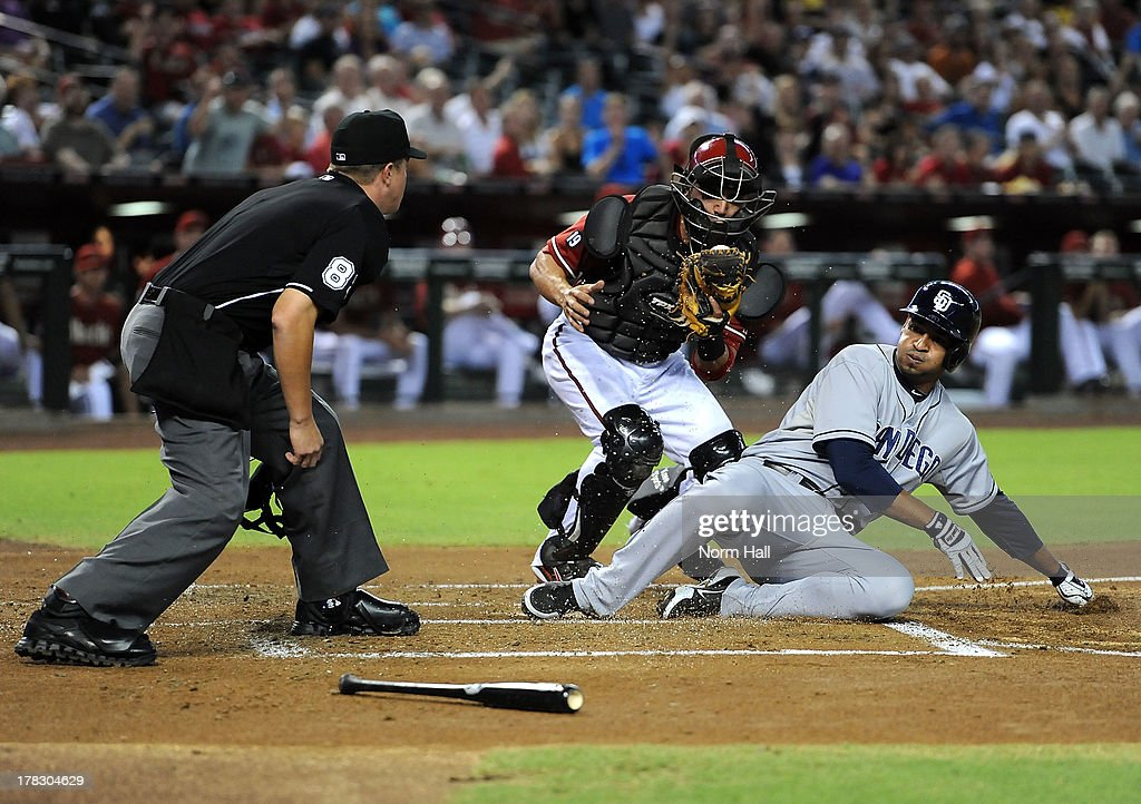 <a gi-track='captionPersonalityLinkClicked' href=/galleries/search?phrase=Wil+Nieves&family=editorial&specificpeople=835752 ng-click='$event.stopPropagation()'>Wil Nieves</a> #27 of the Arizona Diamondbacks tags out Jesus Guzman #15 of the San Diego Padres at home plate at Chase Field on August 28, 2013 in Phoenix, Arizona.