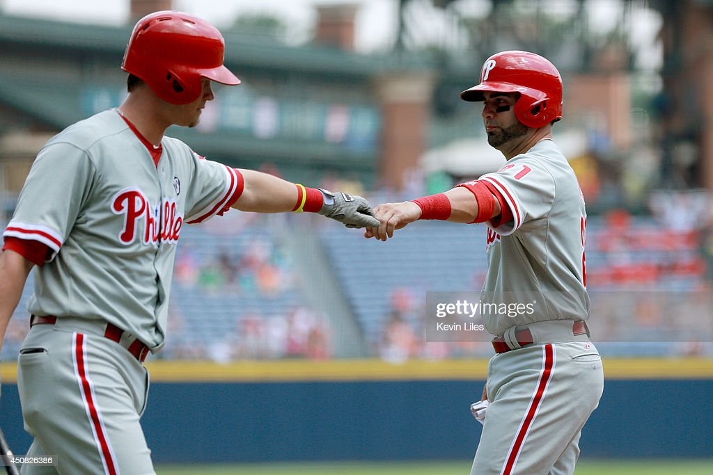 <a gi-track='captionPersonalityLinkClicked' href=/galleries/search?phrase=Wil+Nieves&family=editorial&specificpeople=835752 ng-click='$event.stopPropagation()'>Wil Nieves</a> #21 of the Philadelphia Phillies celebrates scoring against the Atlanta Braves during the first inning at Turner Field on June 18, 2014 in Atlanta, Georgia.