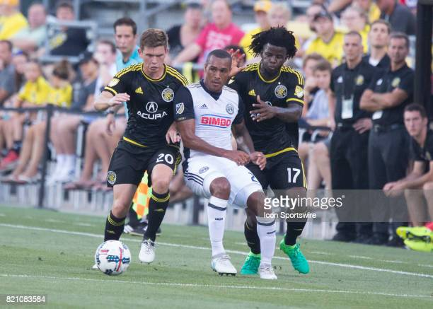 Wil Trapp of Columbus Crew SC and Lalas Abubakar of Columbus Crew SC battle for the ball against Jay Simpson of Philadelphia Union during the game...