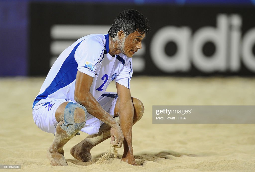 Wilber Alvarado of El Salvador is distraught after his team's defeat in the FIFA Beach Soccer World Cup Tahiti 2013 Quarter Final match between Spain and El Salvador on at the Tahua To'ata Stadium on September 25, 2013 in Papeete, French Polynesia.