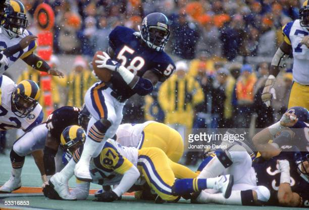 Wilber Marshall of the Chicago Bears recovers a fumble and returns it for a touchdown against the Los Angeles Rams during the 1985 NFC Championship...