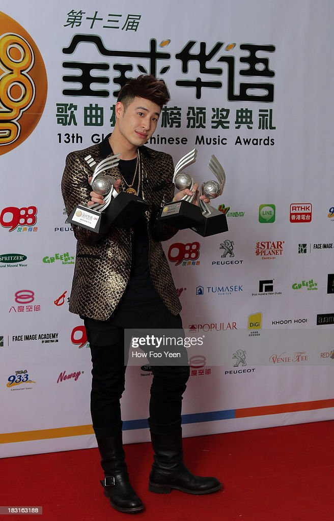 Wilber Pan of Chinese Taipei poses with his Awards at back stage during the 13th Global Chinese Music Awards at Putra Stadium on October 5, 2013 in Kuala Lumpur, Malaysia.