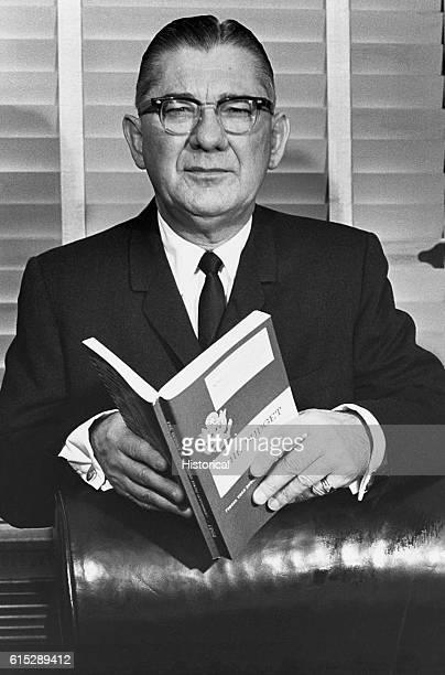 Wilbur Mills holds a book titled The Budget Mills was a Democratic politician in the United States House of Representatives He was forced to resign...