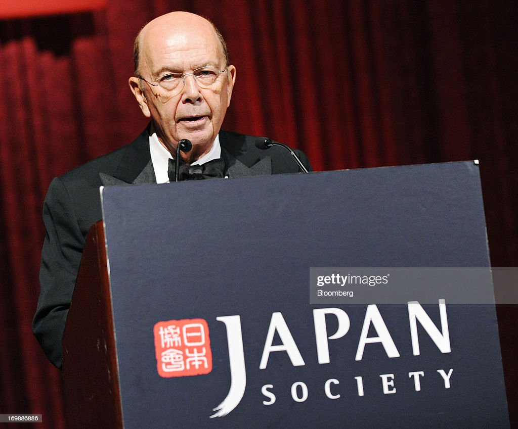Wilbur Ross, billionaire and chief executive officer of WL Ross & Co. LLC, introduces Robert Benmosche, chief executive officer of American International Group Inc. (AIG), unseen, at the Japan Society Annual Dinner in New York, U.S., on Monday, June 3, 2013. AIG hasn't gotten a deposit called for under the deal to sell its plane-leasing unit to a Chinese investor group, presenting another challenge to divesting the business. AIG tumbled the most in six weeks in New York trading. Photographer: Peter Foley/Bloomberg via Getty Images