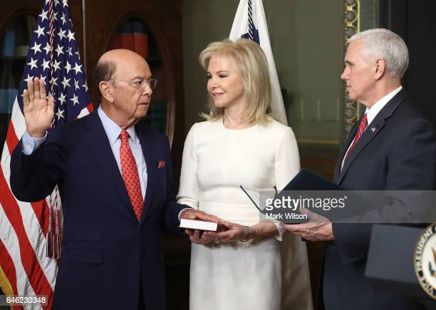 Wilbur Ross is sworn in as Commerce Secretary by Vice President Mike Pence as his wife Hilary Geary Ross holds a bible on February 28 2017 in...