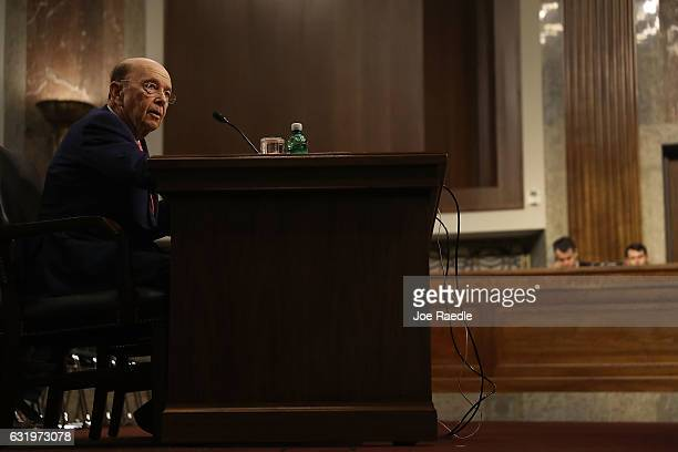 Wilbur Ross picked by Presidentelect Donald Trump to serve as his commerce secretary testify at his confirmation hearing in front of the Senate...
