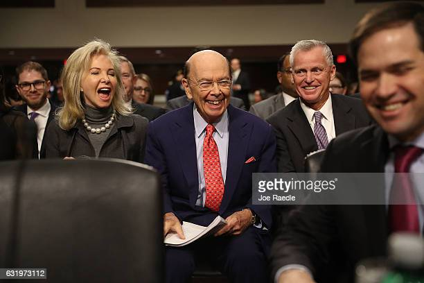 Wilbur Ross picked by Presidentelect Donald Trump to serve as his commerce secretary sits with his wife Hilary Geary Ross as he waits to be...