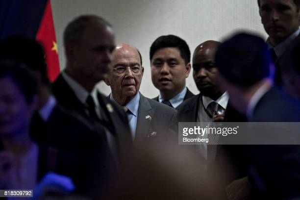 Wilbur Ross US commerce secretary second left arrives to attend a reception ahead of the USChina Comprehensive Economic Dialogue meeting in...