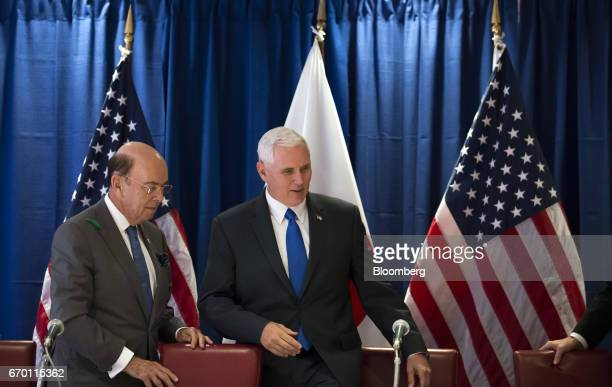 Wilbur Ross US secretary of commerce left and US Vice President Mike Pence take their seats during a meeting with US and Japanese based business...