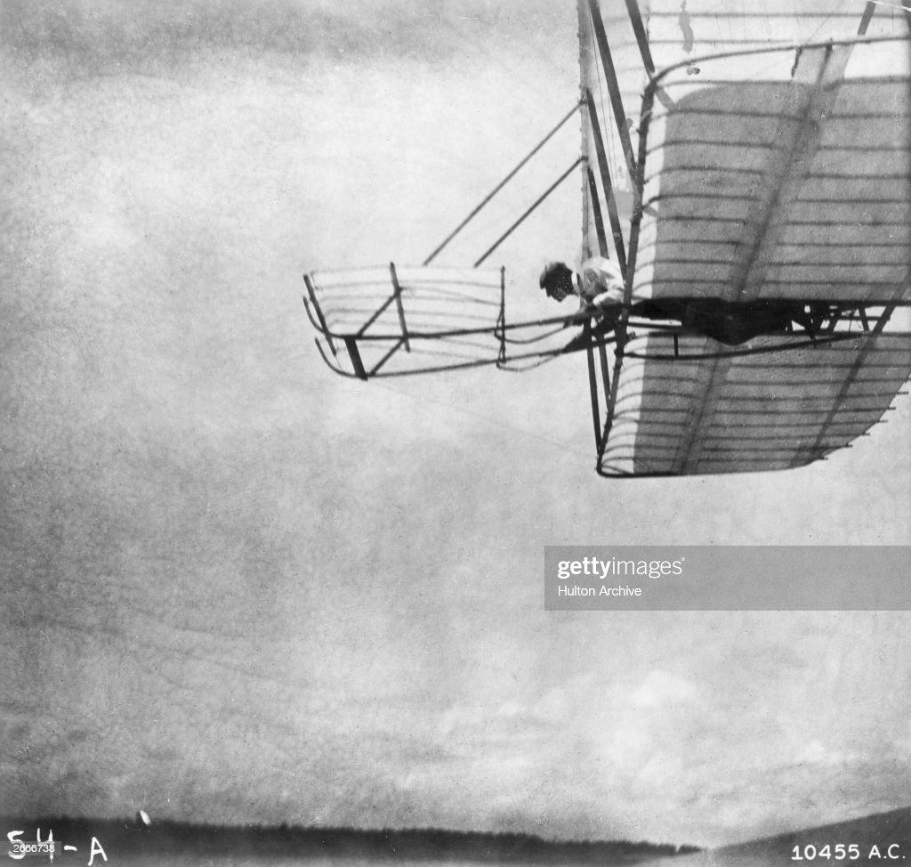 Wilbur Wright flying a 'Wright No 1' glider at Kill Devil Hills, near Kitty Hawk, North Carolina.