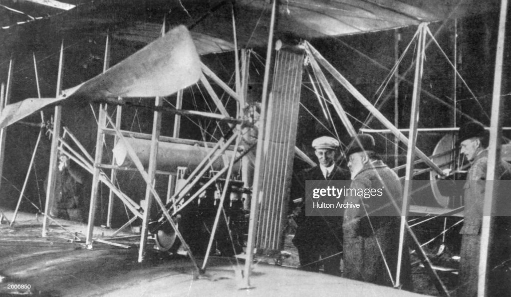 Wilbur Wright showing a 1907 model Flyer to King Edward VII at Pau, France.
