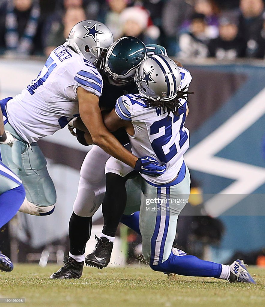 J Wilcox and Kyle Wilber of the Dallas Cowboys tackle Brent Celek of the Philadelphia Eagles and forces a fumble at Lincoln Financial Field on...
