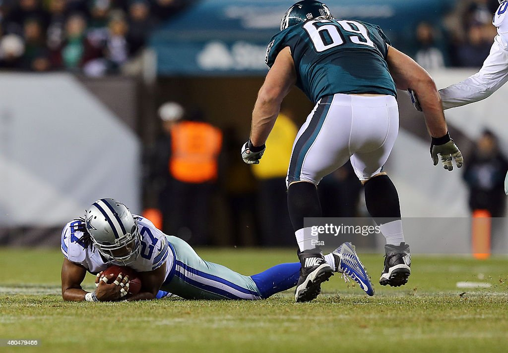 J Wilcox of the Dallas Cowboys covers the ball against the Philadelphia Eagles at Lincoln Financial Field on December 14 2014 in Philadelphia...