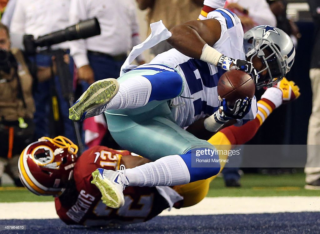 J Wilcox of the Dallas Cowboys intercepts the pass intended for Andre Roberts of the Washington Redskins during the first half at ATT Stadium on...