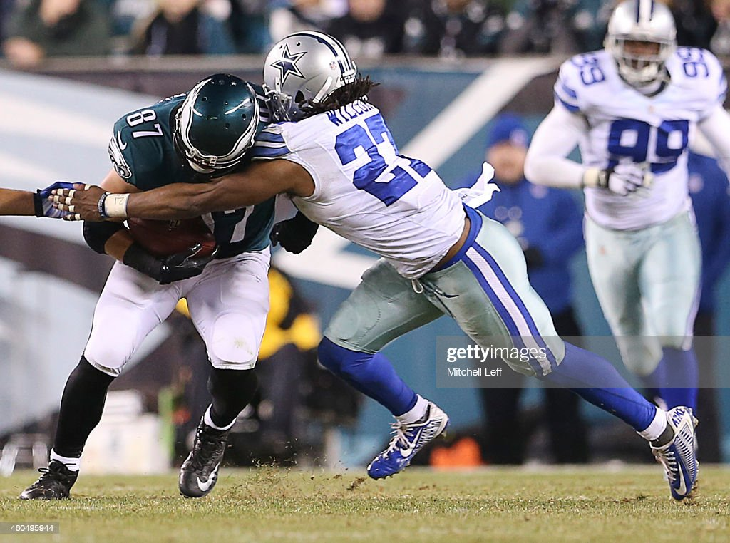 J Wilcox of the Dallas Cowboys tackles Brent Celek of the Philadelphia Eagles and forces a fumble at Lincoln Financial Field on December 14 2014 in...