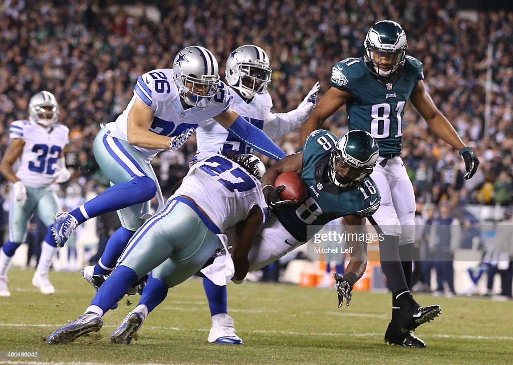 J Wilcox of the Dallas Cowboys tackles Jeremy Maclin of the Philadelphia Eagles at the one yard line at Lincoln Financial Field on December 14 2014...