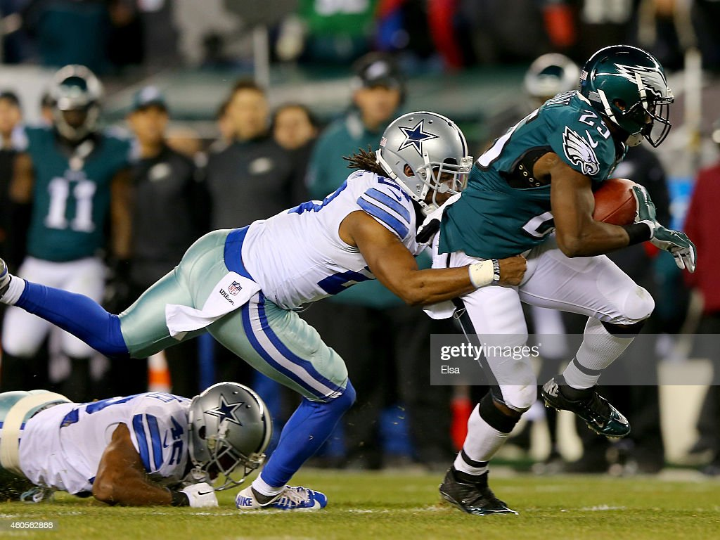J Wilcox of the Dallas Cowboys tackles LeSean McCoy of the Philadelphia Eagles on December 14 2014 at Lincoln Financial Field in Philadelphia...