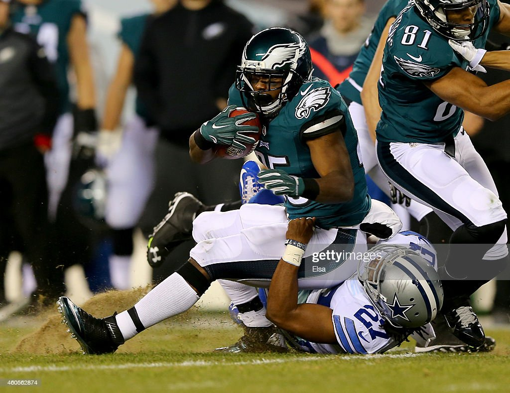 J.J. Wilcox #27 of the Dallas Cowboys tackles LeSean McCoy #25 of the Philadelphia Eagles on December 14, 2014 at Lincoln Financial Field in Philadelphia, Pennsylvania.