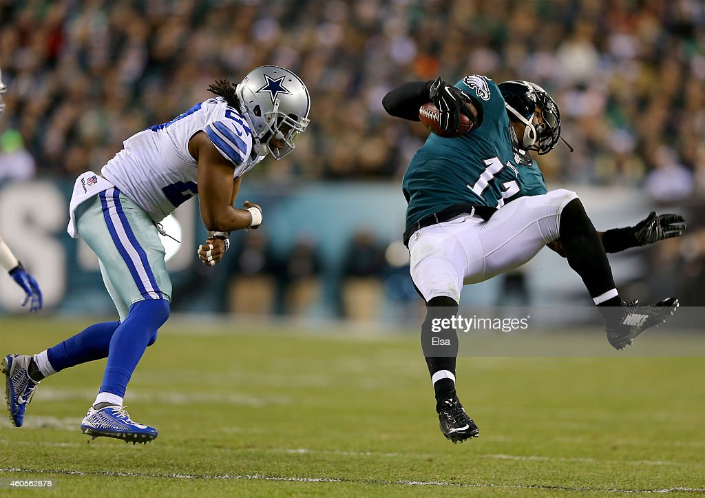 J.J. Wilcox #27 of the Dallas Cowboys tries to stop Josh Huff #11 of the Philadelphia Eagles on December 14, 2014 at Lincoln Financial Field in Philadelphia, Pennsylvania.
