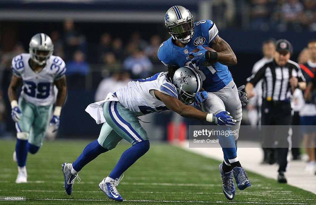 J Wilcox of the Dallas Cowboys tries to tackle Calvin Johnson of the Detroit Lions during the second half of their NFC Wild Card Playoff game at ATT...