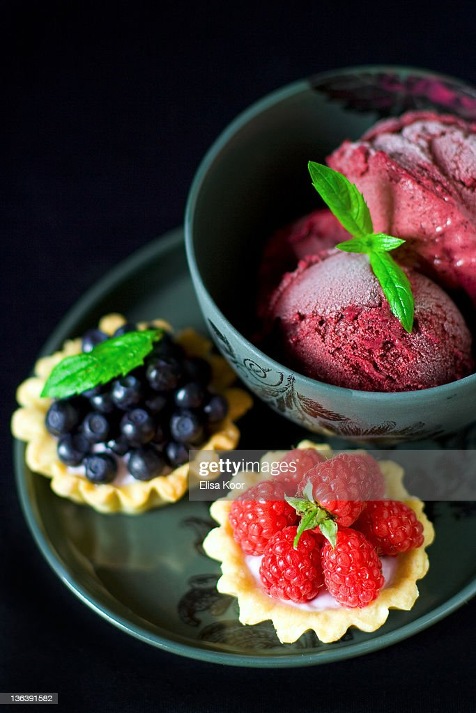 Wild bilberry ice cream and tartlets : Stock Photo