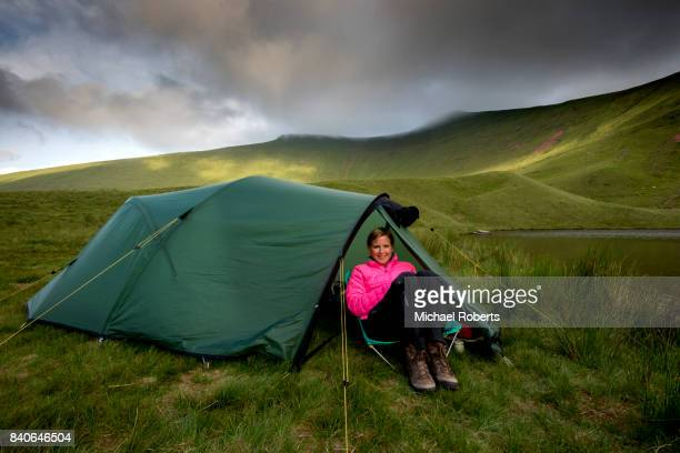 Wild camping (rough camping) on Llyn Cwm Llwch just below Pen y Fan in the Brecon Beacons, Wales.