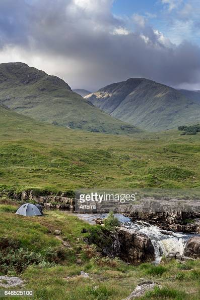 Wild camping with lightweight dome tent along the River Etive in Glen Etive near Glencoe in the Scottish Highlands Scotland UK