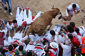 A wild cow jumps over participants at the Pamplona's bullring after the first 'encierro' of the San Fermin Festival in Pamplona northern Spain on...