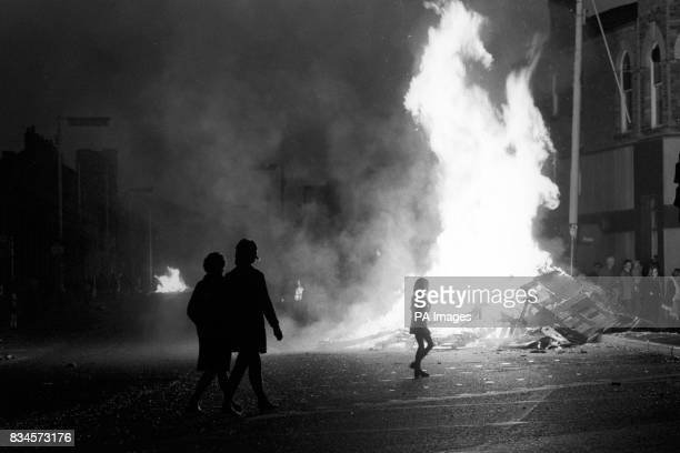 Wild enthusiasm greeted the end of powersharing in the back streets of Belfast One of the celebratory bonfires is seen burning in Protestant East...