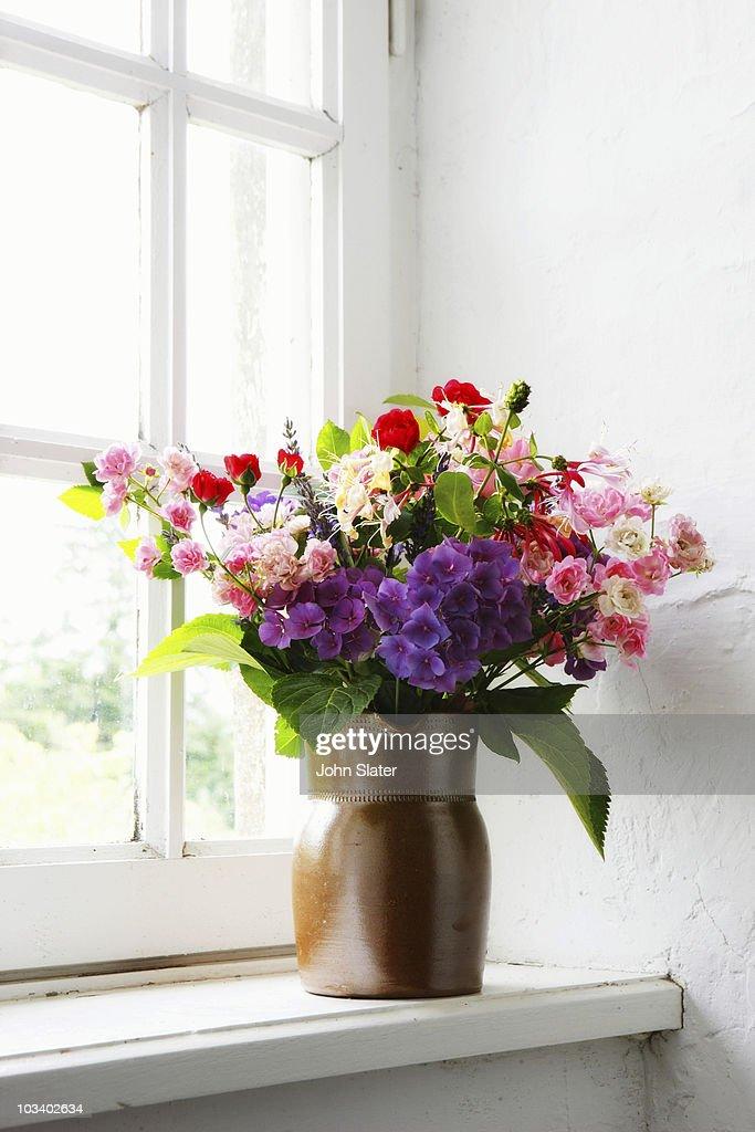 wild flower arrangement in window