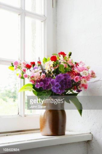 wild flower arrangement in window : Stock Photo