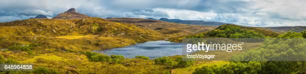 Wild Highlands mountain peaks green glens blue lochs Scotland panorama