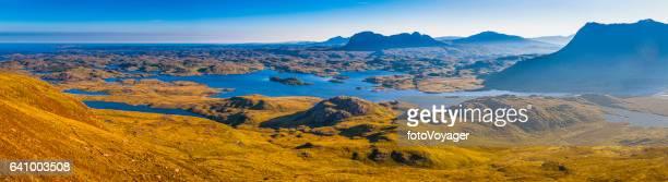 Wild Highlands of Scotland mountain peaks misty glens blue lochs