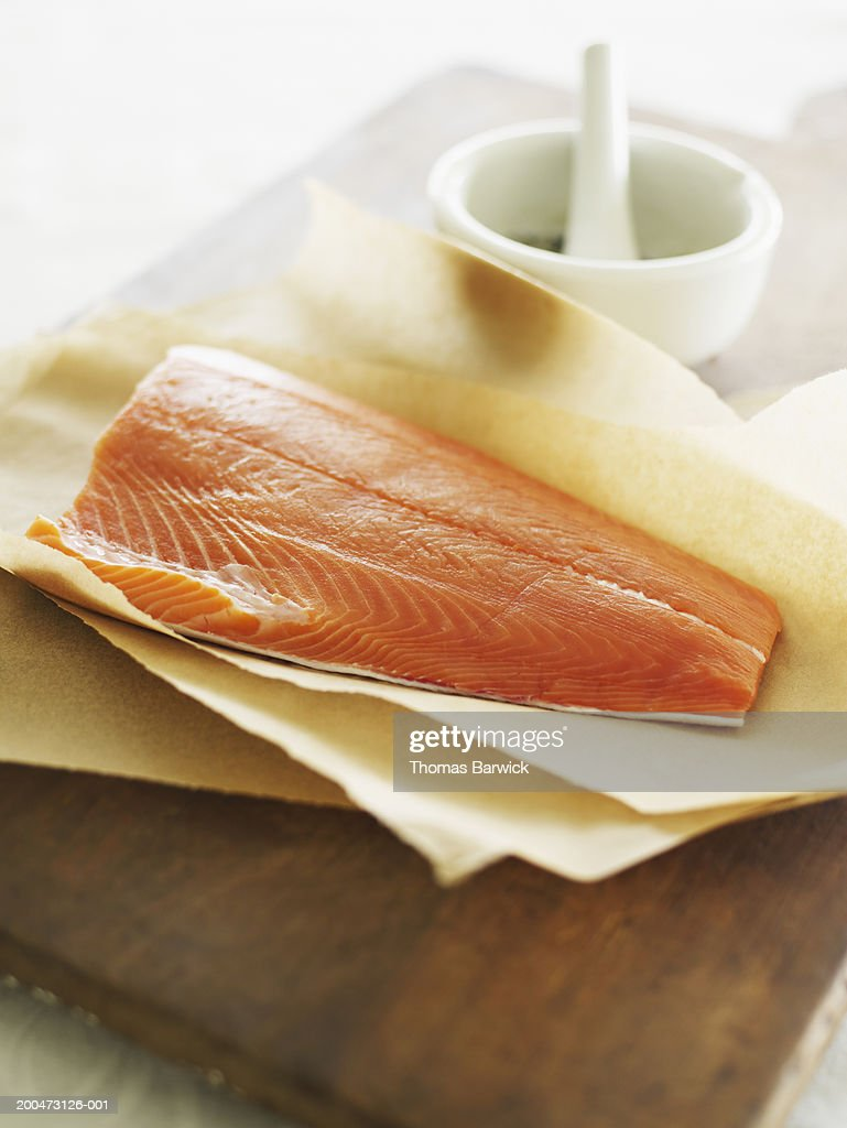 Wild Pacific king salmon fillet on parchment, elevated view
