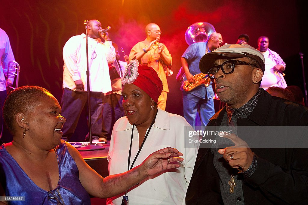 Wild Queen Patrina Peters of the Red Hawk Hunters Mardi Gras Indians, Big Queen Cherise Harrison-Nelson of Guardians of the Flame Mardi Gras Indians and Director Spike Lee dance to the music of Hot 8 Brass Band at the 'Flip the Script' Public Awareness campaign launch at The Joy Theater on October 2, 2012 in New Orleans, Louisiana.