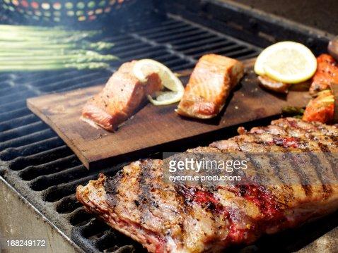 Wild Salmon fillet pork ribs and asparagus bbq