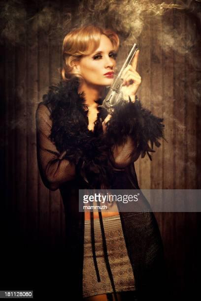 wild west diva holding a smoking gun