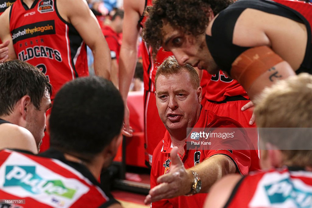 Wildcats coach Rob Beveridge addresses addresses his players at a time-out during the round 23 NBL match between the Perth Wildcats and the Cairns Taipans at Perth Arena on March 17, 2013 in Perth, Australia.