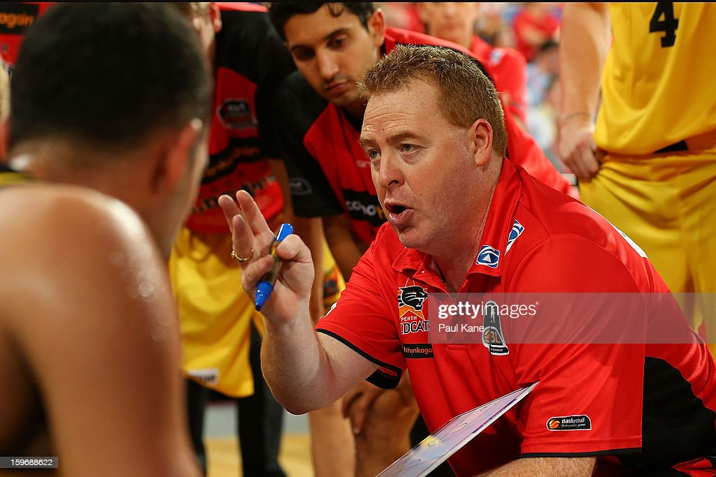 Wildcats coach Rob Beveridge addresses his players in a time out during the round 15 NBL match between the Perth Wildcats and the Cairns Taipans at Perth Arena on January 18, 2013 in Perth, Australia.